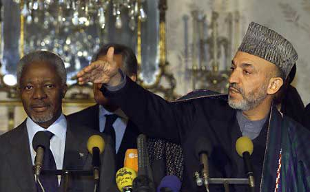 Karzai sworn in as head of interim government